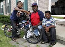 """<p>Alvin Gains, retired Chrysler auto assembly worker after 31 years of employment, sits outside his condominium with his two sons B.J. (L) and Darnell in Sterling Heights, Michigan July 28, 2009. For the second time in 30 years Gains is leaving his home state of Michigan to find work. """"The job market is dead here, said Gains, 56. """"There are college kids who can't find a job, so there's no chance for someone my age"""". REUTERS/Rebecca Cook</p>"""