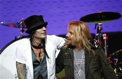<p>Lead singer Vince Neil (R) and drummer Tommy Lee of Motley Crue stand on stage at Avalon in Hollywood, California in this file photo from April 15, 2008. REUTERS/Mario Anzuoni</p>