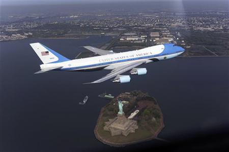 An Air Force presidential aircraft, part of the fleet used by U.S. presidents, is pictured above the Statue of Liberty in New York, in this photograph released to Reuters on May 8, 2009. REUTERS/The White House/Handout