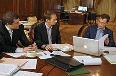 <p>Russia's President Dmitry Medvedev (R), First Deputy Chief of Staff Vladislav Surkov (L) and Kremlin Chief of Staff Sergei Naryshkin prepare the state of the nation address at Gorki residence outside Moscow, November 2, 2008. REUTERS/RIA Novosti/Kremlin/Dmitry Astakhov</p>
