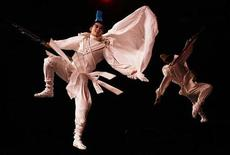 <p>Members of the Beijing Film Academy perform a routine from their production of 'A Midsummer Night's dream' for the photographers for their forthcoming shows in the Edinburgh Fringe Festival, Scotland. REUTERS/David Moir</p>