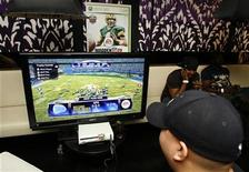 "<p>Guests play the new video game ""Madden NFL '09"" at the Madden NFL '09 VIP Premiere party hosted by EA Sports and XBox in Los Angeles, California August 7, 2008. The game is set for release August 12. REUTERS/Fred Prouser</p>"