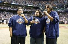 <p>The Los Lonely Boys sing the national anthem before Game 2 of the World Series in St. Petersburg, Florida, October 23, 2008. REUTERS/Hans Deryk</p>