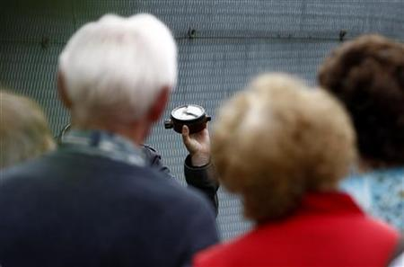 A tourist guide shows an PMN anti-personnel mine used at the former East German border to tourists during a tour in the village of Moedlareuth, about 300 kilometres (186 miles) south of Berlin, July 24, 2009. REUTERS/Fabrizio Bensch