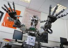 "<p>ICub robot, a ""hybrid embodied cognitive system for a humanoid robot"" about 1 metre (3.2 feet) high, moves his arms during a demonstration at the INSERM institute in Bron, near Lyon, southeastern France, August 31, 2009. REUTERS/Robert Pratta</p>"