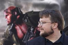 """<p>Director Guillermo del Toro poses for photographers during the premiere of the movie """"Hellboy II The Golden Army"""" in Los Angeles, California, June 28, 2008. The Hollywood studio behind a film based on """"The Hobbit"""" and trustees for author J.R.R. Tolkien's estate said on Tuesday they had settled a lawsuit that clears the way for what is expected to be a blockbuster movie based on the book. The book will be made into two movies by del Toro. REUTERS/Hector Mata</p>"""