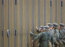 <p>Actors dressed as German Wehrmacht soldiers stand during the shooting of a scene of 'Valkyrie' in front of the German Finance Ministry, the former Reichsluftfahrtministerium (Air Force Ministry), in Berlin August 19, 2007. REUTERS/Hannibal Hanschke</p>