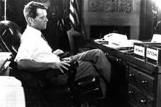 <p>Robert F. Kennedy sits at his desk at the Justice Department in this 1968 file photograph. REUTERS/Handout</p>