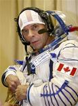 <p>Il miliardario canadese Guy Laliberte, fondatore del Cirque du Soleil, durante l'addestramento per andare nello spazio nel centro spaziale di Star City, vicino a Mosca. REUTERS/Sergei Remezov</p>