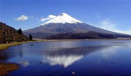 <p>The peak of Cotopaxi, Ecuador's highest active volcano, is reflected in the Limpiopungo lake in the Cotopaxi province in the 2000 file photo. The summits tops out at 19,347 feet or 5,897 metres. REUTERS/Guillermo Granja</p>