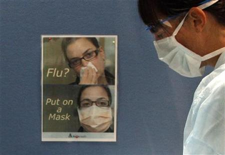 A nurse wears a face mask and protective glasses at a flu clinic in suburban Melbourne June 12, 2009. REUTERS/Mick Tsikas