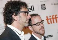 """<p>Directors Joel and Ethan Coen arrive at the """"A Serious Man"""" film screening during the 34th Toronto International Film Festival, September 12, 2009. The festival runs from September 10-19. REUTERS/Mark Blinch</p>"""