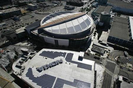 Solar panels are seen atop the roofs of the Nokia Theatre and Staples Center at the L.A. Live entertainment district in downtown Los Angeles in this October 23, 2008 file photo. REUTERS/Fred Prouser/Files