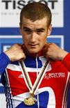 <p>Il ciclista britannico Jonathan Bellis. REUTERS/Wolfgang Rattay</p>