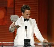 <p>Host Neil Patrick Harris throws his cards after his loss in the category for best supporting actor in a comedy series at the 61st annual Primetime Emmy Awards in Los Angeles, California September 20, 2009. REUTERS/Mario Anzuoni</p>