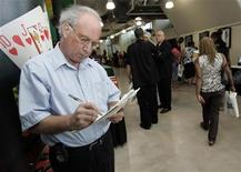 <p>Eugene Salvino, 57, fills out a job application at a job fair in Pittsburgh, Pennsylvania, on August 4, 2009. Salvino's job of 37 years was eliminated a year and a half ago and he's been unable to find a position. REUTERS/Jason Cohn</p>