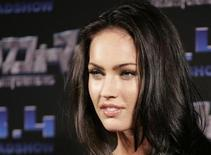 "<p>Actress Megan Fox poses for photographers to promote the film ""Transformers"" in Tokyo May 30, 2007. The film opens in Japan on August 4. REUTERS/Yuriko Nakao</p>"