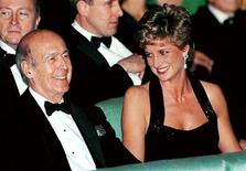 <p>Diana, Princess of Wales (R) turns and laughs with former French President Valery Giscard d'Estaing, in this November 28, 1994 file photo where the two attended the theatre and dinner at the Chateau de Versailles. REUTERS/John Schults/Files</p>