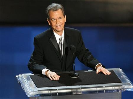 Dick Clark stands onstage during a tribute to him at the 58th annual Primetime Emmy Awards at the Shrine Auditorium in Los Angeles August 27, 2006. REUTERS/Mike Blake