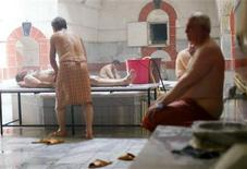 <p>Men rest in a traditional hammam (bath) in Kayseri, central Turkey, in this June 27, 2006 file photo. REUTERS/Umit Bektas/Files</p>
