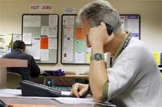 <p>A job seeker makes a phone call to a potential employer at The Work Place, which provides comprehensive employment and career services in Boston, Massachusetts July 2, 2009. U.S. REUTERS/Brian Snyder</p>