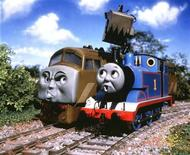 <p>Thomas the Tank Engine (L) and Diesel 10 are seen in this undated publicity photo. REUTERS/Handout</p>