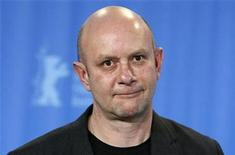 <p>Writer Nick Hornby poses during a photocall to promote the movie 'An Education' at the 59th Berlinale film festival in Berlin, February 10, 2009. REUTERS/Johannes Eisele</p>