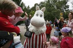 <p>A Moomin character meets visitors at Moomin World theme park in Naatali, July 9, 2008. In one of the quirkiest book cults America has never heard of, a round-snouted troll is hauling consumers' wallets from their pockets despite the worst recession in decades. The license-holders for Moomin, who say license sales increased 35 percent this year, are contemplating expansion. REUTERS/Bob Strong</p>