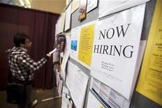 <p>A man looks at a job board posted at a job fair in Toronto, April 1, 2009. REUTERS/Mark Blinch</p>