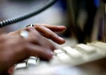 <p>A person types on a keyboard in this undated file photo. REUTERS/Files</p>