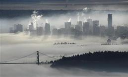 <p>The downtown core of Vancouver and the Lions Gate Bridge rise above a morning fog in this view from Cypress Mountain in West Vancouver, British Columbia November 17, 2008. REUTERS/Andy Clark</p>