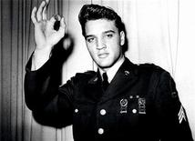 <p>Elvis Presley is pictured in his United States Army uniform in this undated publicity photograph. REUTERS/Handout</p>