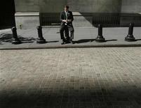 <p>A trader sits outside the New York Stock Exchange October 6, 2008. REUTERS/Shannon Stapleton</p>