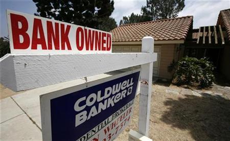 A bank owned home is advertised for sale in Encinitas, California August 18, 2009. REUTERS/Mike Blake
