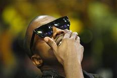 <p>Hip hop artist Kanye West watches Game 1 of the NBA Finals basketball game between the Los Angeles Lakers and Orlando Magic in Los Angeles, June 4, 2009. REUTERS/Mike Blake</p>