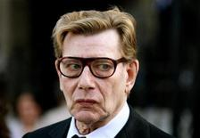 <p>French fashion designer Yves Saint Laurent walks outside the Sainte Clothilde Church after funeral services for Lugi d'Urso, the late husband of French designer Ines de la Fressange, in Paris March 27, 2006.</p>