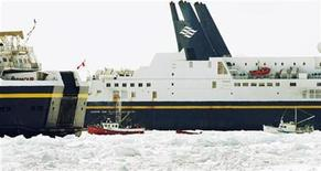 <p>Two sealing boats navigate towards a break in the ice created by the two passing car ferries Caribou (L) and the Joseph and Clara Smalllwood (R) as they try to leave Sydney harbour, Nova Scotia, March 28, 2009. REUTERS/Paul Darrow</p>
