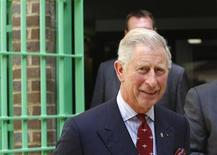 <p>Britain's Prince Charles walks during a visit to the Belmarsh prison in southeast London September 10, 2009. REUTERS/Lefteris Pitakharis/Pool</p>