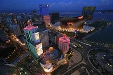 <p>A general view of local and foreign casinos in Macau, including Hotel Lisboa (in pink) and Wynn Macau (with orange lines), in the evening of July 20, 2007. REUTERS/Dennis Ho</p>