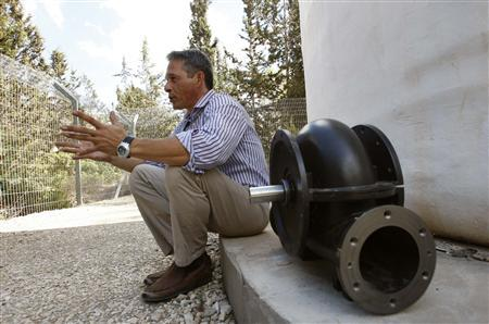 Leviathan's COO Gadi Hareli sits next to an in-pipe hydroelectric turbine during an interview with Reuters in Neve Shalom, near Jerusalem October 22, 2009. REUTERS/Gil Cohen Magen/Files