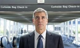 """<p>Actor George Clooney is shown in a scene from his new film """"Up In The Air"""" in this undated publicity photograph. REUTERS/Dale Robinette/Paramount Pictures/Handout</p>"""