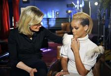 "<p>Singer Rihanna (R) is shown with ABC newswoman Diane Sawyer in this publicity photograph released by ABC November 5, 2009, in an exclusive interview for ABC's program ""20/20"" talking publicly for the first time what happened between her and singer and ex-boyfriend Chris Brown, who was sentenced to community labor, five years of probation and one year of domestic-violence counseling for attacking Rihanna in 2009. REUTERS/Ida Mae Astute/ABC/Handout</p>"