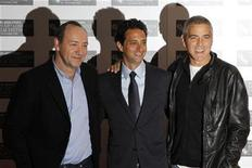 """<p>Cast members Kevin Spacey (L) and George Clooney (R) stand with director Grant Heslov as they arrive to speak about their new film """"The Men Who Stare At Goats"""" in London, October 15, 2009. REUTERS/Stefan Wermuth</p>"""