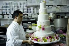 <p>Buddy Valastro puts the finishing touches to one of his signature cakes at his bakery earlier this year in Hoboken, New Jersey, in this handout photo. REUTERS/Heather Swanson</p>