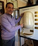 <p>Inventor Luciano Marabese displays a prototype of his holy water dispenser at his office in Capriano Briosco, around 40 km (25 miles) north of Milan November 10, 2009. REUTERS/Stefano Rellandini</p>