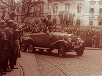 <p>Nazi leader Adolph Hitler waves to crowds in his six seater Mercedes car in this undated World War II file photo. REUTERS/Handout</p>