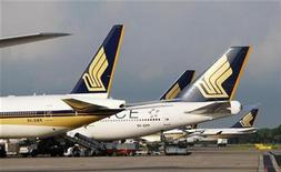 <p>The tail fins of parked Singapore Airlines (SIA) aircraft are pictured at Changi Airport in Singapore, May 13, 2009. REUTERS/Vivek Prakash</p>