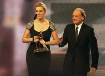 <p>British actress Kate Winslet makes a speech after being presented with a Bambi award for Best International Actress from actor Bruno Ganz (R) during the 61st Bambi media awards ceremony in Potsdam November 26, 2009. REUTERS/Tobias Schwarz</p>