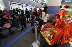 <p>Shoppers line up for Black Friday sales at the Disney store in Glendale, California November 27, 2009. Americans headed to department stores in droves in the dead of night on Friday to kick off the holiday shopping season, though many said they had pared back how much they would spend on family members and on themselves. Black Friday, the day after U.S. Thanksgiving, is often the single busiest shopping day of the crucial holiday season, which accounts for nearly one-fifth of the retail industry's annual sales. REUTERS/Phil McCarten</p>