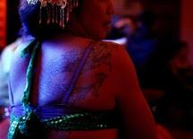 <p>A drag queen performer is seen at a bar in Dali, Yunnan province, November 23, 2009. REUTERS/Stringer</p>